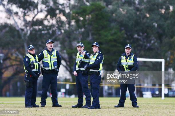 Police patrol the area before a vigil held in memory of murdered Melbourne comedian 22yearold Eurydice Dixon at Princess Park on June 18 2018 in...