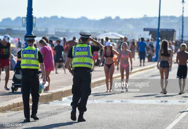 Police patrol the beach on June 25, 2020 in Bournemouth, United Kingdom. A major incident was declared by the local council as thousands flocked to...