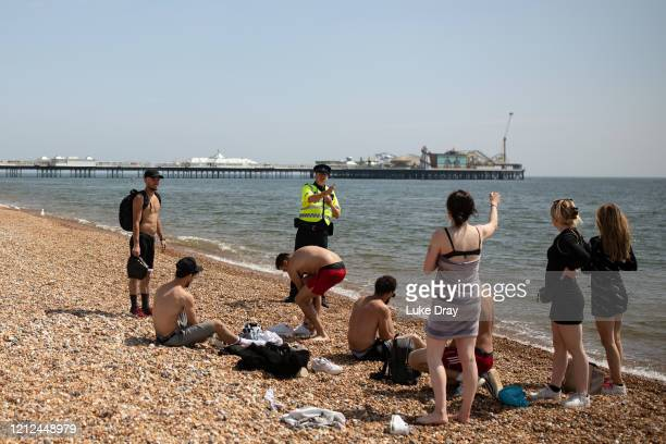 Police patrol the beach on May 09, 2020 in Brighton, England. Officers are asking people to observe lockdown rules, and asking people who aren't to...