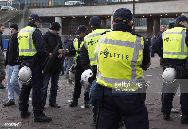 Police patrol the grounds outside the Amsterdam Arena stadium before the kick off of a UEFA Cup League match between Ajax Amsterdam and Manchester...
