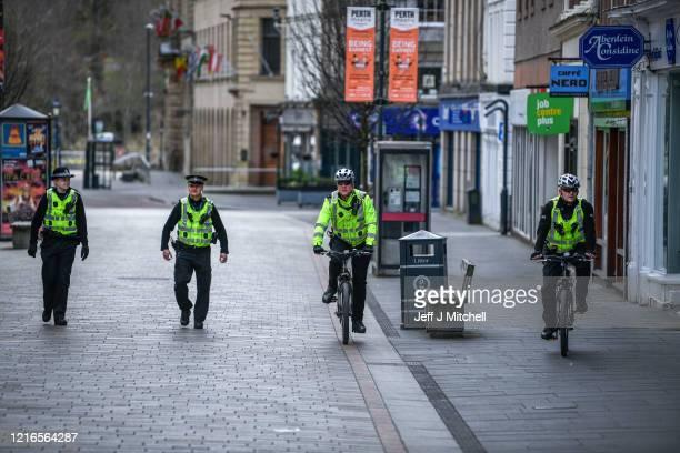 Police patrol the High Street during the Coronavirus lockdown on April 3 2020 in PerthScotlandThe Coronavirus pandemic has spread to many countries...