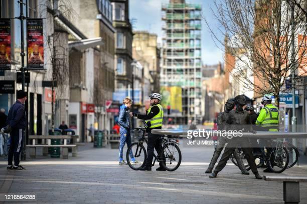 Police patrol the High Street during the Coronavirus lockdown on April 3, 2020 in Perth,Scotland.The Coronavirus pandemic has spread to many...