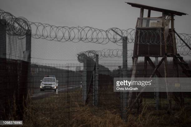Police patrol the Hungarian border fence with Serbia on January 18 2019 outside Szeged Hungary In 2015 thousands of migrants massed on the Hungarian...