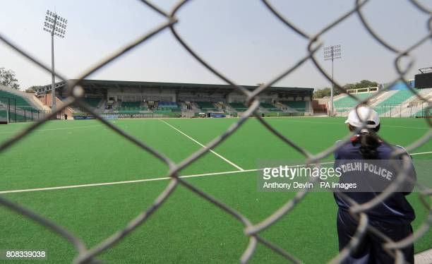 Police patrol the interior of the Dhyan Chand National Stadium the venue for hockey during the 2010 Commonwealth Games in New Delhi India
