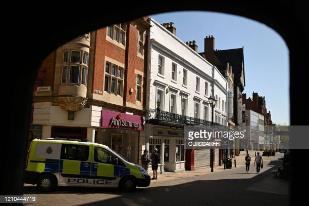 Police patrol the neardeserted streets of Lincoln Eastern England on April 20 as life in Britain continues during the nationwide lockdown to combat...