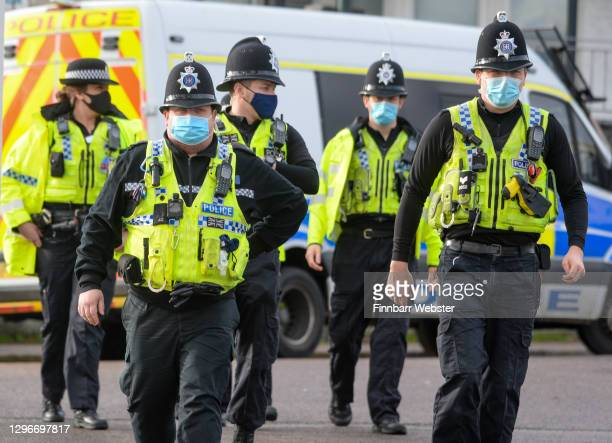 Police patrol the promenade and seafront on January 16, 2021 in Bournemouth, Dorset. With a surge of covid-19 cases fueled partly by a more...