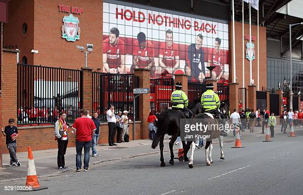 Police patrol the streets ahead of the Barclays Premier League match between Liverpool and Watford at Anfield on May 08, 2016 in Liverpool, England.