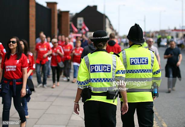 Police patrol the streets ahead of the Barclays Premier League match between Liverpool and Watford at Anfield on May 08 2016 in Liverpool England