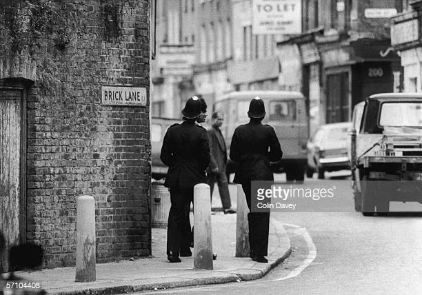 Police patrol the streets in the Brick Lane area of East London following clashes between Asian residents and members of the farright National Front...