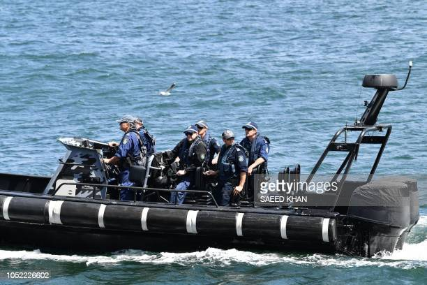 Police patrol the Sydney Harbour during Britain's Prince Harry and his wife Meghan visit to the iconic Opera House on October 16 2018 Prince Harry...