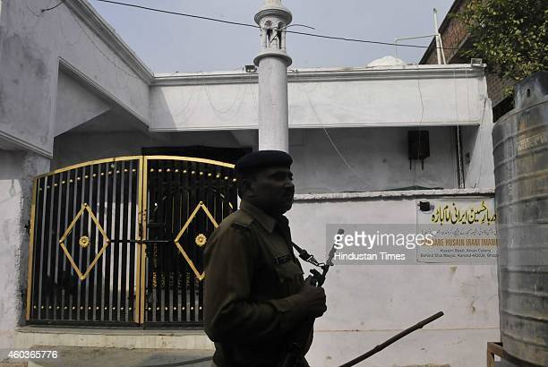 Police patrolling a deserted street of Aman colony at Karond area on December 12 2014 in Bhopal India Two sects of a religious community clashed in...
