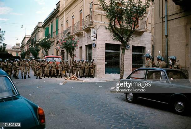 Police patrolling a road in the centre of Reggio Calabria where there are disturbances due to the decision taken by the Provincial Capital Reggio...
