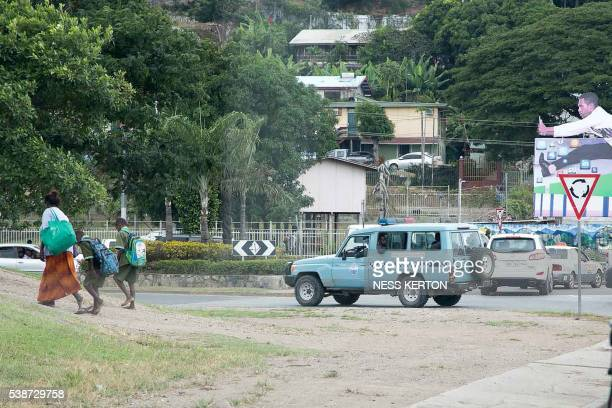 Police patrols the area around the University of Papua New Guinea following a protest rally by the students in Port Moresby on June 8 2016 Police in...