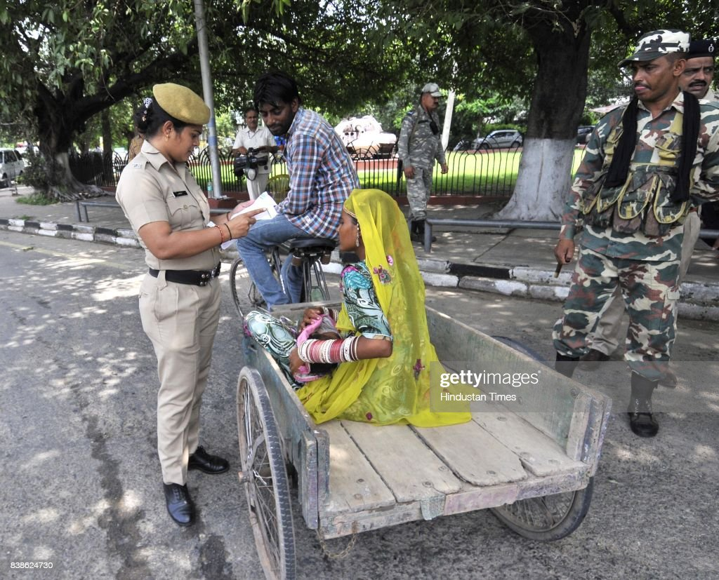 Police personals checking the I Card of localities in sector 2 on August 24 2017 in Panchkula India The godman was charged with rape of a female...