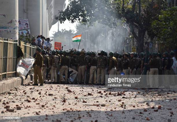 Police personnel and protestors seen during clashes between a group of anti-CAA protestors and supporters of the new citizenship act, at Jaffrabad on...