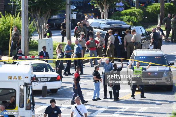 Police personnel are seen not far from a building where a shooting took place at the Capital Gazette on Thursday June 28 2018 in Annapolis MD Several...