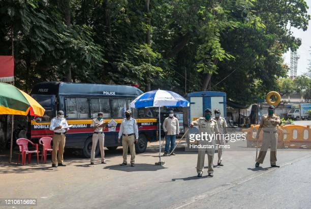 Police personnel at a checkpost on Sion Panvel Highway during lockdown against coronavirus at Govandi on April 21 2020 in Mumbai India