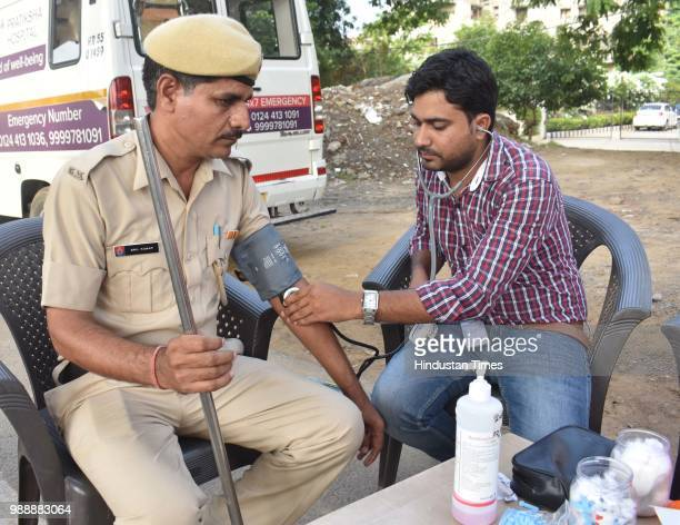 A police personnel attends a health camp held during a Raahgiri Day an event organised by MCG at Sector 55 Golf Course Road in Gurugram India on...