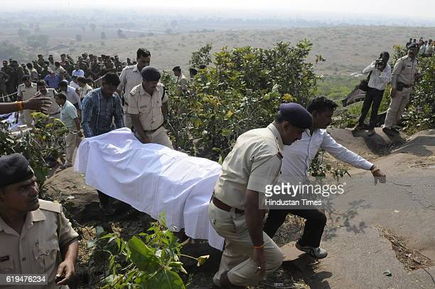 Police personnel carrying the body of SIMI terrorists killed in an encounter at Acharpura on October 31 2016 in Bhopal India Eight SIMI terrorists...