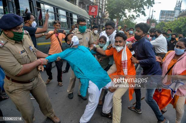 TOPSHOT Police personnel catch activists of Bharatiya Janata Party as they shout slogans during an antiChina protest in Siliguri on June 17 2020...