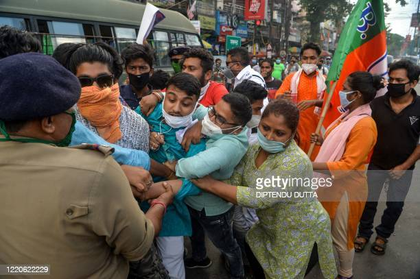 Police personnel catch activists of Bharatiya Janata Party as they shout slogans during an antiChina protest in Siliguri on June 17 2020 India and...