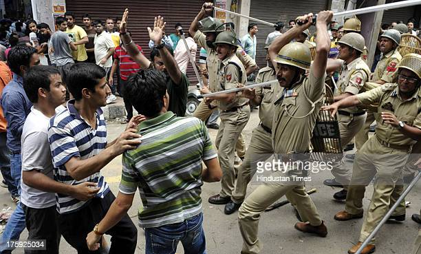 Police Personnel charged lathi on protestors during a clash between protestors and Indian police officials on August 10 2013 in Jammu India A town in...