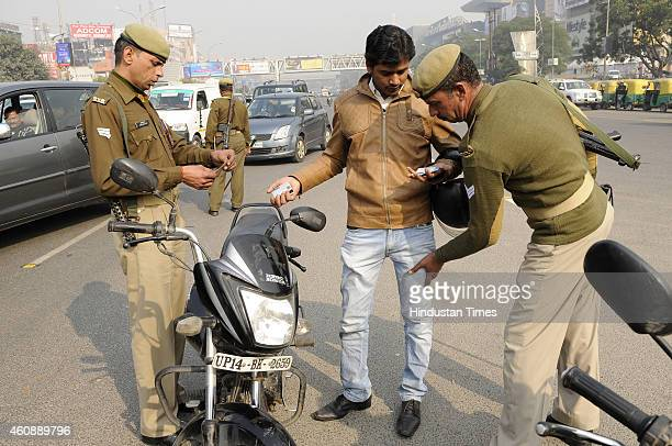 Police personnel checking a commuter as security has been tightened in the city after high alert was declared following a bomb blast at Bengaluru on...