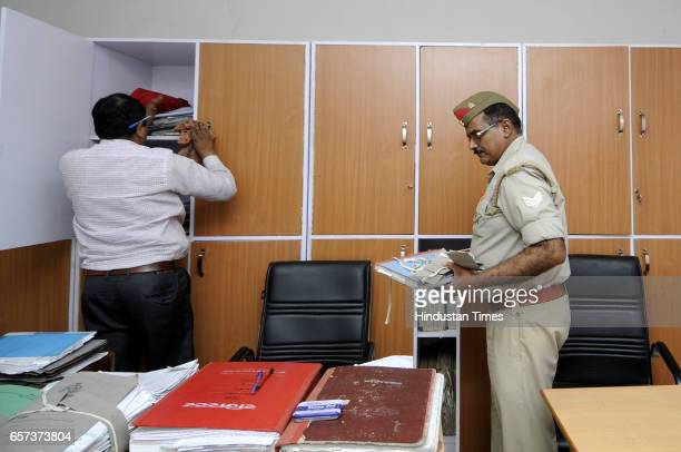 Police personnel clean the office at police station on March 24 2017 in Noida India New UP Chief Minister Yogi Adityanath has ordered that the drive...
