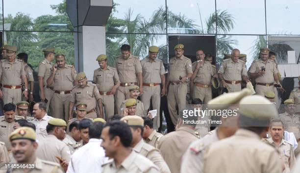 Police personnel deployed at a counting centre a day ahead of the 2019 Lok Sabha vote counting, at Phool Mandi on May 22, 2019 in Noida, India....