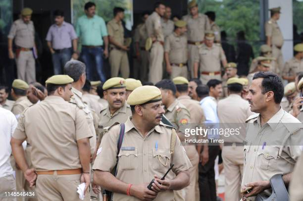 Police personnel deployed at a counting centre a day ahead of the 2019 Lok Sabha vote counting at Phool Mandi on May 22 2019 in Noida India Counting...