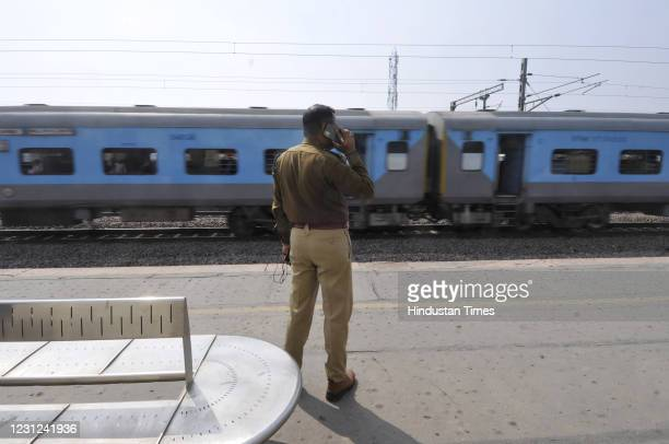 Police personnel deployed at Dankaur railway station to ensure enforcement of law and order as farmers take part in Rail Roko protest against farm...