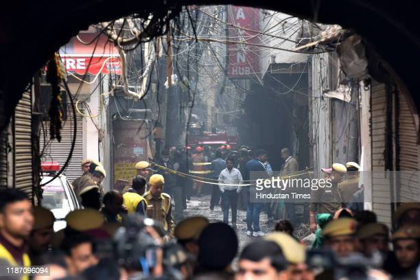 Police personnel deployed at the spot where a fire broke out in a plastic factory, at Anaj Mandi, Filmistan on December 8, 2019 in New Delhi, India....