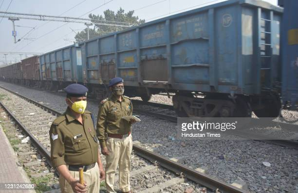 Police personnel deployed during a nationwide Rail Roko against new farm laws at Modi Nagar Railway Station on February 18, 2021 in Ghaziabad, India....