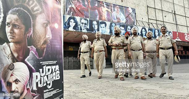 Police personnel deployed on duty outside the cinema hall after release of movie Udta Punjab at Aanaam Cinema hall as various Hindu organizations...