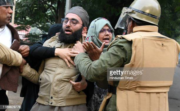 Police personnel detain demonstrators during an anti Citizenship Amendment Act and National Register of Citizens protest at Parivartan Chowk area on...