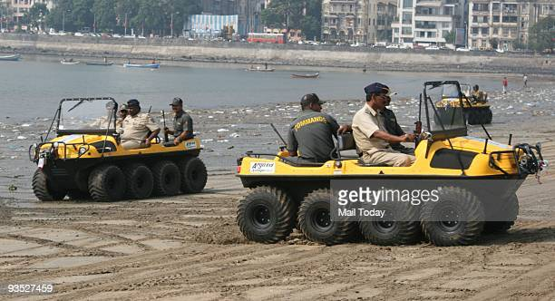 Police personnel display allterrain vehicles inducted for city police force for patrolling the costal area at Girgaum Chowpatty on the eve of the...