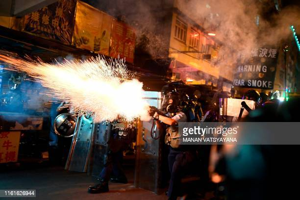TOPSHOT Police personnel fire teargas shells to disperse ProDemocracy protestors in the Sham Shui Po Area of Hong Kong on August 14 2019 More than 10...