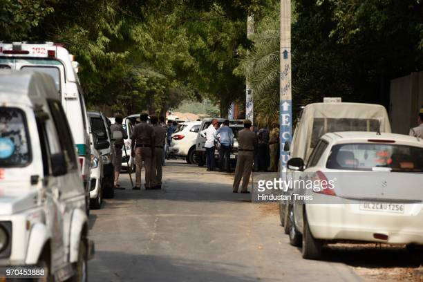 Police personnel inspect the site of an encounter between the Special Cell and a gang of criminals in the Fatehpur Beris Chanan Hola village near...
