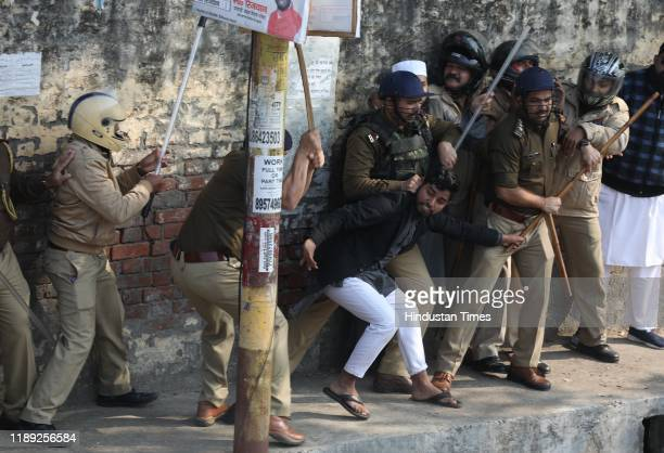 A police personnel manhandles a student of Nadwa college during a protest against the Citizenship Amendment Act and the police crackdown on students...