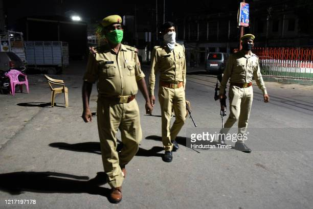 Police personnel on patrol during night curfew at Tandon Chauraha on June 1, 2020 in Lucknow, India.