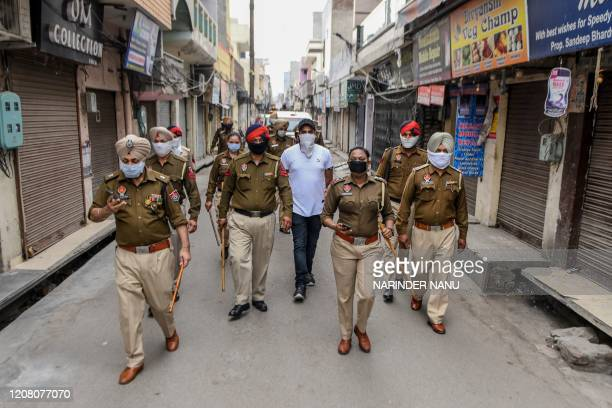 Police personnel patrol on a street during a government-imposed lockdown as a preventive measure against the COVID-19 coronavirus, in Amritsar on...