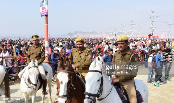 Police personnel seen as devotees arrive to take a dip on the occasion of Paush Purnima during the Kumbh Mela at Sangam on January 21 2019 in...
