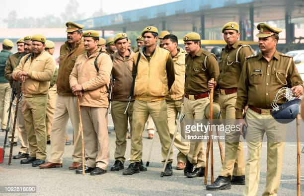 Police personnel seen during a protest by farmers at DND flyway toll gate for the demand of compensation for the acquired land, on February 2, 2019...