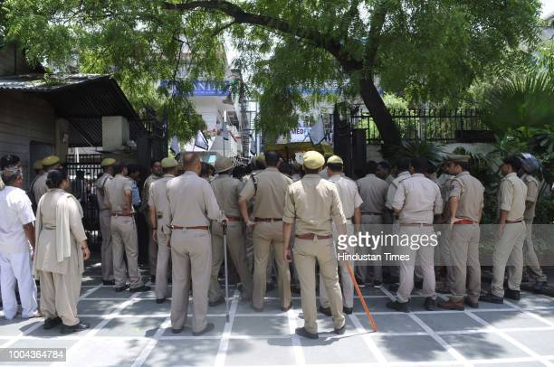 Police personnel seen outside the Noida authority office at sector 6 during a farmers protest on July 23 2018 in Noida India