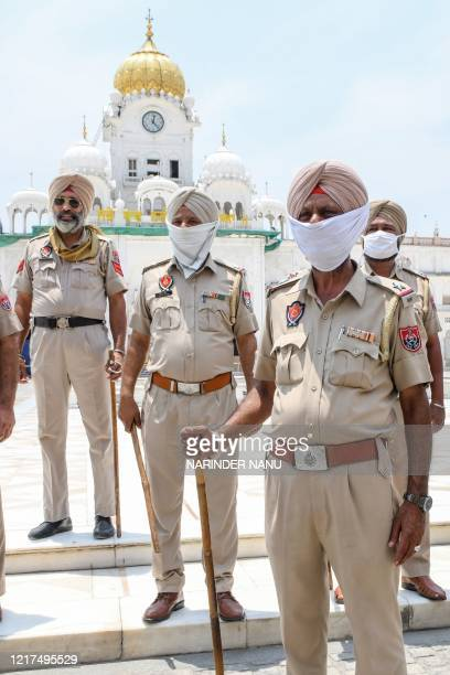 Police personnel stand guard ahead of the 36th Operation Blue Star Anniversary outside the Golden Temple in Amritsar on June 4, 2020. - The Indian...