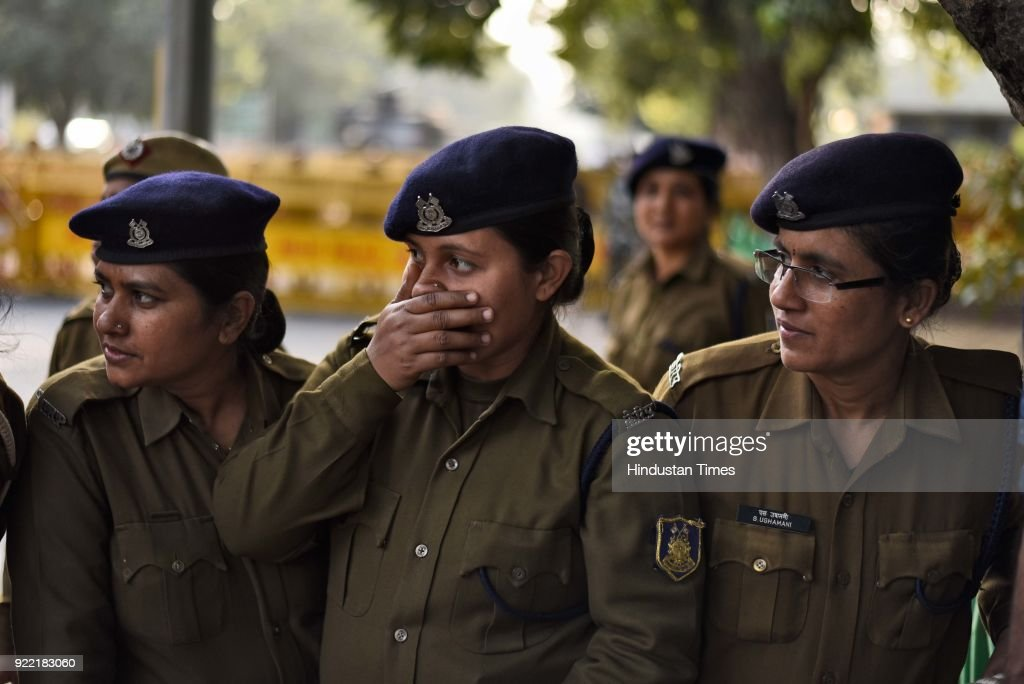 Police personnel stand guard during a protest march of Indian Youth Congress against Finance Minister Arun Jaitley and Punjab National Bank (PNB) scam at IYC office, on February 21, 2018 in New Delhi, India.