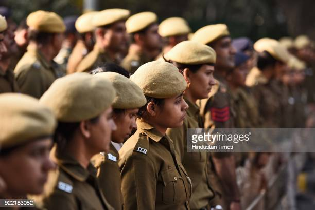 Police personnel stand guard during a protest march of Indian Youth Congress against Finance Minister Arun Jaitley and Punjab National Bank scam at...