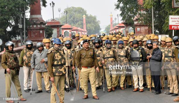 Police personnel stand guard during anti CAA protest, Old City on December 20, 2019 in Lucknow, India. According to senior police officials, about...