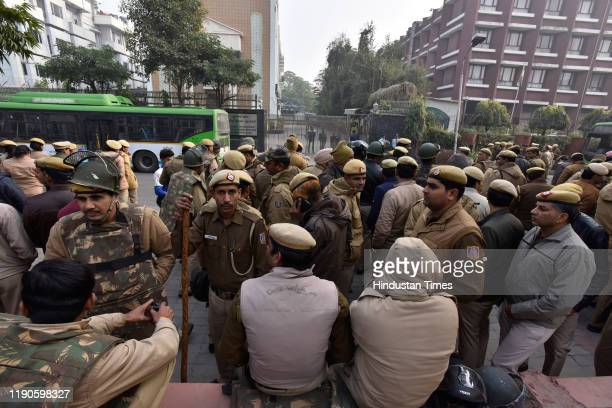 Police personnel stand guard outside the Uttar Pradesh Bhawan ahead of a protest by students against the Citizenship Amendment Act and Uttar Pradesh...