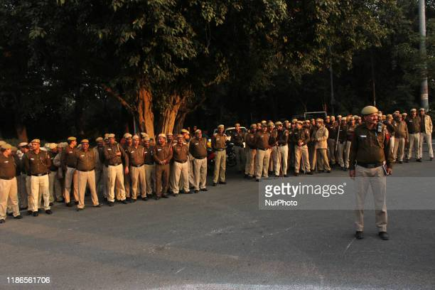 Police personnel stand guard to stop student march at Rajghat as Delhi Commission for Women chief Swati Maliwal launched an indefinite hunger strike...